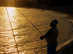Pescando al atardecer (Guervs) Tags: sunset espaa beach water atardecer fisherman andaluca spain agua playa andalucia granada grenade almucar pescador ltytr2 ltytr1 ltytr3 superhearts a3b