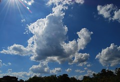 Sun and clouds over Walter Reed1 (Tiz_herself) Tags: blue sky sun nature clouds nikon day cloudy rays d40x