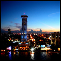 warm  bangkok night (DocTony Photography) Tags: travel cruise light sunset building water night river thailand hotel boat bravo asia warm ship nightscape nightshot bangkok hilton relfection warming bff sustainable global superfriends chaoprayariver rivercruise sustain canon30d supertony 1755is mywinners henyo superaplus aplusphoto holidaysvancanzeurlaub infinestyle doctony milleniumhiltonhotel