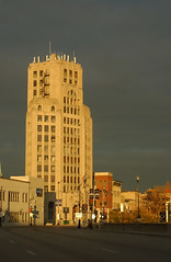 Elgin Tower in Pending Storm (Adam FLiK) Tags: street sky sun storm building tower rain clouds contrast dark illinois downtown bright sunny elgin looming pending flikproductionscom flikproductions adamflikkema