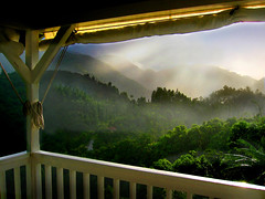 Sunshower on the Verandah (Rick Elkins) Tags: bravo bluemountains jamaica tropical verandah sunshower soe naturesfinest blueribbonwinner supershot magicdonkey mywinners abigfave flickrgold shieldofexcellence anawesomeshot colorphotoaward superaplus aplusphoto superbmasterpiece goldenphotographer ithinkthisisart focuslegacy excapture rickelkins