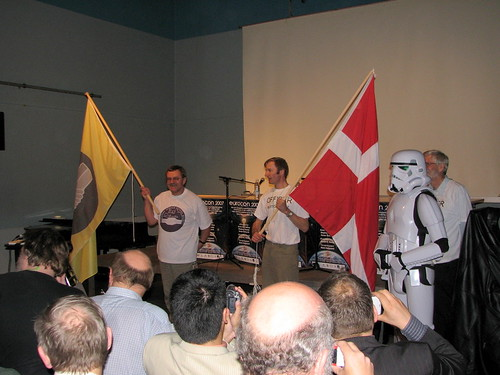 Dave Lally holding the ESFS flag, and Olav Christiansen the Danish flag, with a Stormtrooper standing by