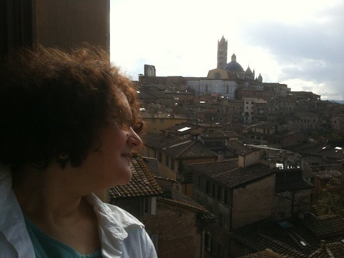 NK at hotel room window, Siena