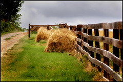 Haystack (DyeDye) Tags: photoshop fence nikon path availablelight rustic nikond100 naturallight missouri haystack dirtroad hay d100 beaten 2007 darksky rollsofhay girlphotographer maldenmissouri inthemiddleofnowhereoff