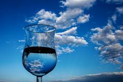 sky grappa (duegnazio) Tags: blue sky glass clouds canon 350d nuvole vivid cielo canon350d riflessi bicchiere 2007 grappa q8 riflesso romamor oniricamente top20blue cieloromano duegnazio vividmasters