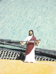 Jesus shows off his souvenir from the man