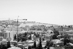 Israel 2007-06-12 R3-04 BW (Exothermic) Tags: city urban blackandwhite building film church wall skyline architecture 35mm landscape gold hotel israel cityscape citadel jerusalem domeoftherock belltower dome jewish  convent  oldcity ascension redeemer olivet mountofolives towercrane jaffagate   towerofdavid erlserkirche bellhowell davidsgate         sheratonplaza  hebrongate    pz3300