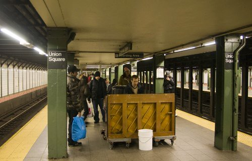 Guy playing the piano on a NYC subway platform; Union Square, 14th Street
