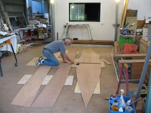 Plywood being cut out for the Quick Canoe