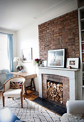 joanna-goddard-house (It's Great To Be Home) Tags: blue brown white cozy fireplace rustic livingroom rug neutral stackedwood