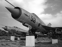 MiG 21s (three-B) Tags: bw memorial war asia crash military jets jet vietnam communist hanoi jetfighter mig aerospace warplane vietnamwar aeronautic mig21 mig19 mikoyangurevichmig21mf mikoyangurevichmig21pf