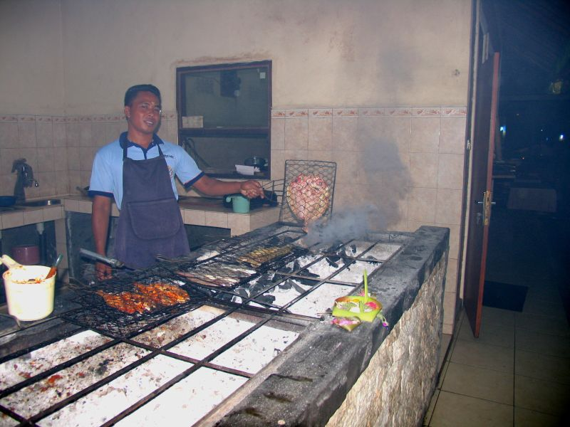 Cooking fresh seafood at Cafe Ayodya, Jimbaran