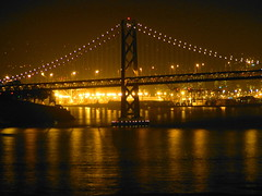 Lights of Oakland (Carl_C) Tags: reflection water lights oakland nightlights august citylights baybridge 2007 oaklandbaybridge lamplights abigfave anawesomeshot