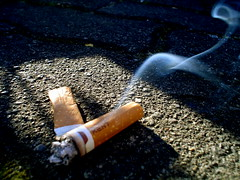 Cigarette in your bed... or in the street. (tralala colori ) Tags: street sol calle cola humo vereda cigarro cigarrillo colilla