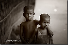 Brothers in Arms (Shabbir Ferdous) Tags: portrait kids photographer stmartin bangladesh bangladeshi canoneos5d ef70200mmf28lisusm shabbirferdous wwwshabbirferdouscom shabbirferdouscom