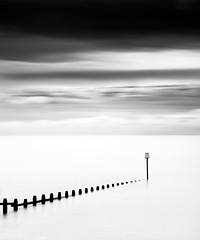 Succession (Andy Brown (mrbuk1)) Tags: ocean longexposure sky cloud seascape motion water contrast mono blackwhite still mood horizon fineart minimal devon marker simple groyne bold dawlishwarren