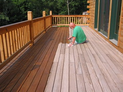 Me staining the deck.