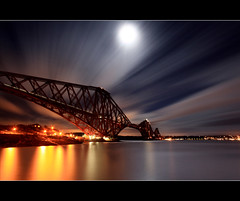 Forth Rail Bridge - Moonlight (angus clyne) Tags: road new old bridge blue light sea cloud moon seascape black beach water ferry night silver river dark lens coast scotland fly moving high edinburgh long exposure wind fife angus south north scottish wave rail east full queens forth lee filters magical firth northqueensferry clyne landsape colorphotoaward