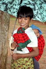 Young girl with baby sibling. (Linda DV) Tags: street travel portrait people cute face barn children geotagged kid asia southeastasia child candid burma young 1999 kind myanmar criana enfant nio dziecko bambino  birmanie kalaw   travelphotography lapsi copil dijete  dt birmania  travelportrait   flickrdiamond lindadevolder
