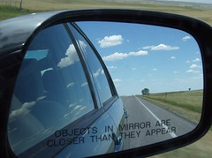 Objects May Appear As The Illusions They Are (Fran 53) Tags: vacation sky storm reflection car clouds mirror view south rear july wyoming dakota deadwood 2007