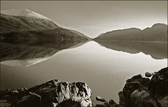 Helvellyn  winter reflection - Thirlmere,Lake District National Park (johnlunt) Tags: england blackandwhite bw mountain lake slr film topf25 water rock 35mm canon john landscape photography mono photo mood image photos district fineart picture dramatic photographic cumbria apx100 analogue agfa reflexions helvellyn photogenic lunt thirlmere specialpicture flickraward eos30e usm28135is wainwrightcoasttocoast masterpiecesoflightdark