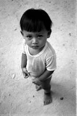 Cambodge - Cambodia - 2000 (Negative scan) (- PicsmaKer -) Tags: trip travel boy vacation blackandwhite bw white holiday black art canon children eos photo asia cambodge cambodia noir child photos nb jeunesse asie enfants 50e blanc ilford eos50e