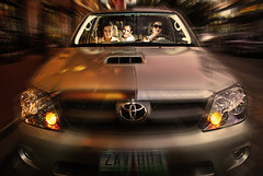 speed (TyC) Tags: auto lighting light car sunglasses mobile night speed asian reading three moving nikon automobile asia driving sitting zoom flash philippines fast running move multiplicity ty rush transportation toyota driver passenger hurry triplets clone seated peeking triple speeding davao fortuner davaocity tyron d80 strobist nikonstunninggallery tyroncruz tycruz
