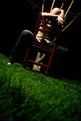 matt and the red chair (3) (holly schumacher) Tags: cigarette barefoot frontyard greengrass mattpeace momsredchair becksshirt