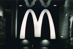 i'm lovin' it (starsinmysocks) Tags: bw film sign hongkong mcdonalds nikonfm2