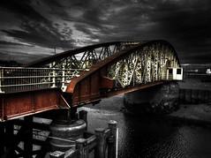 Burnt Red Bridge - Ramsey, Isle of Man (isdky) Tags: bridge red sky water photoshop hdr isleofman ramsey iphone photoshoppery dodgeandburn redbubble iphone4 iphoneography