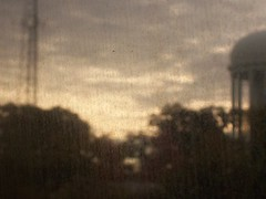 north carolina train view (paper whistle) Tags: brown window out blurry focus quiet watertower north raleigh dirty carolina vague eastern subtle