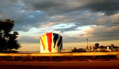 dorchester bay at 60 mph (sandcastlematt) Tags: street blur boston clouds plane airplane october highway driving tank massachusetts keyspan 93 dorchester gastank bostonist outthecarwindow dorchesterbay universalhub abigfave
