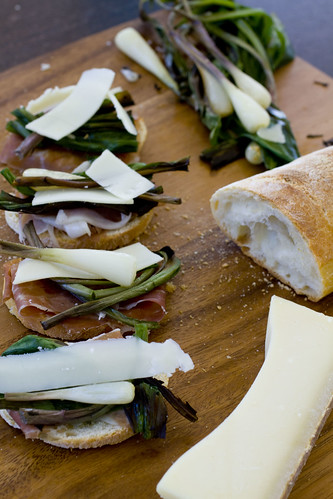 Prosciutto, ramps, and gruyere on wood board 8