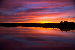 Evening at it's Finest (Mark Veitch) Tags: sunset reflection water colors tag3 taggedout clouds highway tag2 tag1 windsor bayoffundy lightpoles causeway novescotia