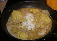 6.)  quickly add condensed soup and half tub of cream cheese, stir until melted and blended