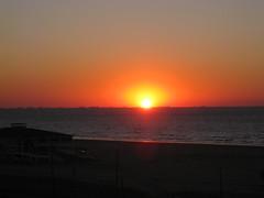Sunrise at Galveston (Hawk40) Tags: morning orange sun galveston beach gulfofmexico water yellow sunrise texas tx ships galvestontx mywinners flickrdiamond platinumheartaward mygearandme