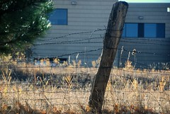 Fence (Let Ideas Compete) Tags: school fence wire post boulder massage essence therapy barbwire barbed gunbarrel