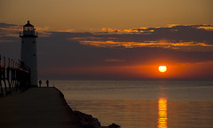 Sunset at Manistee Lighthouse (SheldonBranford (RichGreenePhotography.com)) Tags: sunset sky lighthouse water clouds reflections pier michigan lakemichigan manistee 0111 jesters bigmomma blueribbonwinner michiganlighthouse cotcmostinteresting d80 specland nikonstunninggallery 1on1sunrisesunsetsphotooftheday challengeyouwinner 060907 anawesomeshot diamondclassphotographer flickrdiamond flickrchallengewinner sunsets20070609 1on1sunrisesunsetsphotoofthedayjune2007 thechallengegame challengegamewinner theperfectphotographer nginationalgeographicbyitalianpeople richgreenephotography