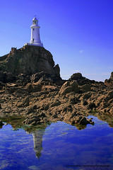 Corbiere Lighthouse - Jersey, Channel Islands (jerseyimage) Tags: ocean greatbritain blue sea portrait sky lighthouse reflection canon reflections concrete outside islands marine rocks raw day landmark calm september jersey dslr navigation channelislands channel constructed corbiere 1874 stbrelade corbierelighthouse top20lh 400d top20lh20 jerseyimage johncoode lighthousesofthebritishisles wbnawgbchi