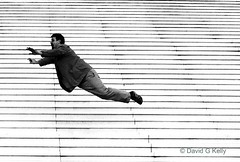 I Believe I Can Fly (Dave G Kelly) Tags: bw paris france flying magic flight steps ladefense illusion extra lartigue hitchhikersguidetothegalaxy grandearche ger legrandearche supershot 25faves aplusphoto platinumheartaward davegkelly