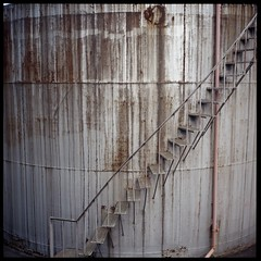 Tank of Rust (gullevek) Tags: brown building 6x6 film japan metal wall architecture silver iso100 kodak pipes rusty  kanagawa  kawasaki housebuilding sampo   scannedfromnegative kodakektachromee100vs pipesandmachines rolleiflex28c epsongtx900 thegoodcollection geo:lat=35521113 geo:lon=139743924