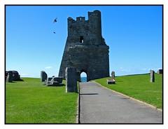 Aberystwyth Castle (David Reece) Tags: blue sea sky david bird castle beach monument grass wales clouds seaside sand day waves stones sony flight sunny cybershot starling aberystwyth dsch2