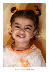 .. (Nasser Bouhadoud) Tags: orange baby girl face canon eos 350d sister hind nasser doha qatar saher  allil