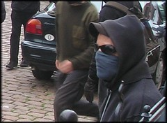 Black Blocker (thealmightyprophetgitboy) Tags: black sunglasses youth germany hoodie mask politics protest demonstration anarchism bloc balaclava rostock manifestation 2007 g8 classwarrior egalitarianism autonomiste