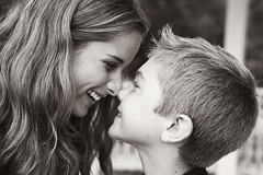 Eskimo kiss (scoopsafav) Tags: family boy portrait bw love girl kids sisters laughing portraits fun outdoors blackwhite kid brothers outdoor sister brother teen laughter leighduenasphotography