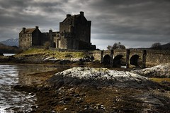 Eilean Donan Castle (bgladman) Tags: uk travel bridge castle water silhouette clouds landscape photography scotland photo highlands nikon d70 unitedkingdom britain stock escocia explore loch nikkor hdr highdynamicrange eileandonan schottland dornie scozia lochduich cosse kyleoflochalsh tonemapped    brendangladman