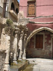 Windows overlooking an old fountain, Rethymno, Crete (winninator) Tags: door pink fountain beautiful arch decay greece crete venetian crumbling rethymno rethymnon lpwindows