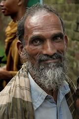 almost smiling... (janchan) Tags: poverty old portrait people man smile asia retrato documentary dhaka ritratto bangladesh reportage povertà pobreza whitetaraproductions nishkriti