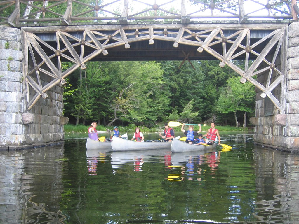 "Canoeing under the bridge to ""Eagles Nest"" a famous Great Camp in the Adirondacks"