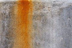 orange stain (xgray) Tags: orange texture stain wall digital upload canon austin 50mm prime rust university texas gray cement surface universityoftexas iphoto rebelxt ef50mmf18 jestercenter